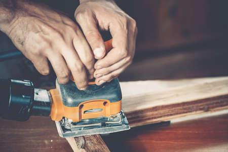 carpenter: male carpenter at work close up