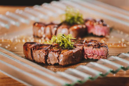 steak beef: Grilled bbq steaks with herbs on wooden table