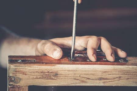 wood trade: male carpenter at work close up