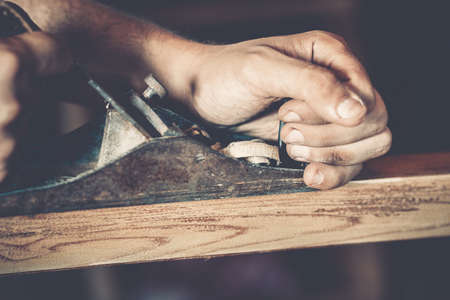 wooden furniture: male carpenter at work close up