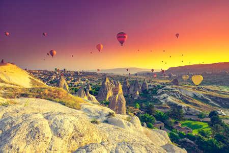 Hot air balloons flying over spectacular Cappadocia