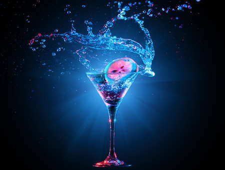 martini: Colourful cocktail in glass with splash on the dark background