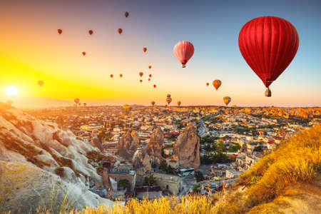 Hot air balloons flying over spectacular Cappadocia Stock Photo