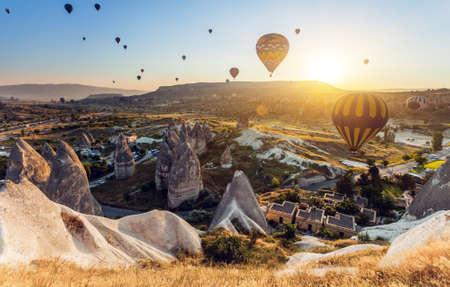 goreme: Hot air balloons flying over spectacular Cappadocia Stock Photo