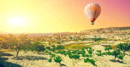 spectacular: Hot air balloon flying over spectacular Cappadocia Stock Photo