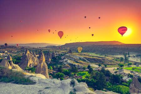 spectacular: Hot air balloons flying over spectacular Cappadocia Stock Photo