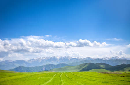 lawn grass: Beautiful landscape with green mountains and magnificent cloudy sky Stock Photo