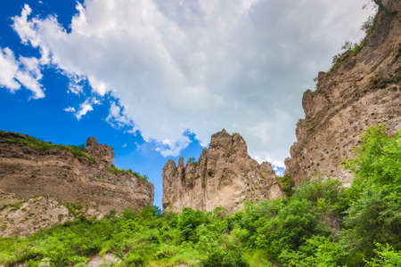and magnificent: View on mountain cliffs and magnificent cloudy sky on background. Exploring Armenia Stock Photo