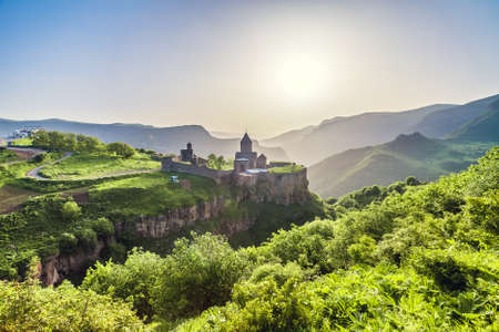 tatev: Ancient monastery in setting sun. Tatev. Armenia