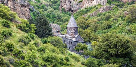 caved: Old UNESCO object Geghard monastyr - Armenia summer day. Exploring Armenia Stock Photo