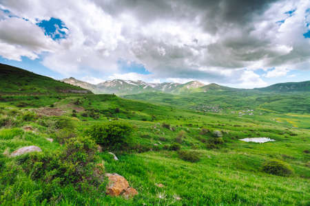 Beautiful landscape with green mountains and magnificent cloudy sky. Exploring Armenia Stock Photo