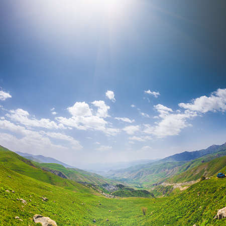 and magnificent: Beautiful landscape with green hills and magnificent cloudy sky. Exploring Armenia Stock Photo