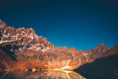 Himalaya Mountain landscape. Dudh pokhari Gokyo lake and Phari Lapche peak at sunrise - Gokyo - Way to Cho Oyu Base Camp - Nepal. Beautiful nature landscape. Travel background.