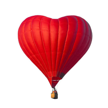Beautiful red air balloon in the shape of a heart isolated on a white background. Romantic date present trip on Valentines Day. Sports and recreation travel theme. Love symbol Imagens
