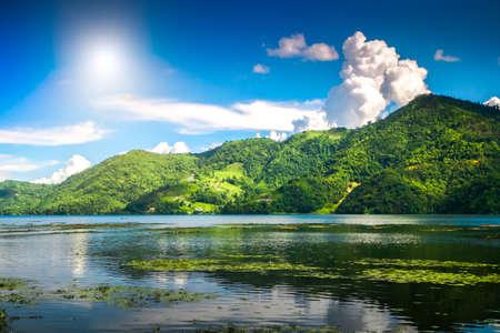phewa: Beautiful green hills landscape with reflection on water at Phewa lake, Pokhara. Relax after trekking in Himalaya mountains, Nepal. Nature landscape. Travel background. Holidays and recreation