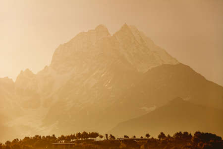 The misty Thamserku Mountain in the Namche Bazaar Region. The Himalayas. Eastern Nepal. Ideal background in beige, bright brown tints for the illustrations and collages. Banco de Imagens