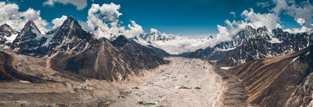Breathtaking panoramic view in the Gokyo Lakes region. The mighty snow-covered mountain range on the way to the Everest Base Camp in the Nepal. Strength and beauty of the untouched nature.