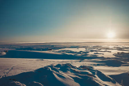 Bright sunrise panorama of the Antarctica. Overwhelming polar landscape. The winter sun over the snow covered frozen land. Ideal background for the collages and illustrations. Antarctic South Pole 스톡 콘텐츠