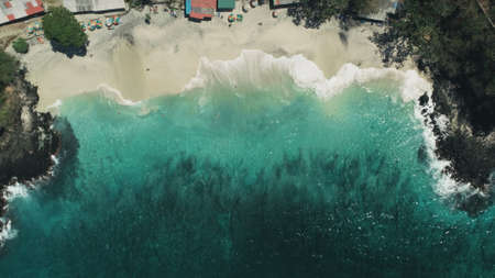 Ocean Waves and White Sand Beach. Crystal Water Landscape in Tropical Bali Island, Indonesia. Travel Vacation Recreation