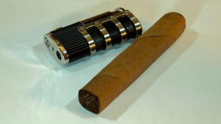 cigar lighter and hand made cigar Foto de archivo