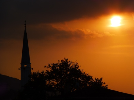 minaret silhouette at beautiful sunset photo