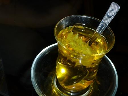 sage tea with traditional tea glass and turkish flag shaped teaspoon Stock Photo - 22571668