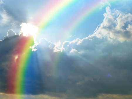 beautiful double rainbow cloudy blue sky Stock Photo