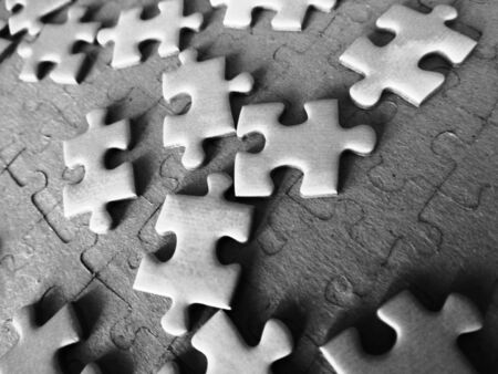 puzzle,jigsaw pieces monochrom photo