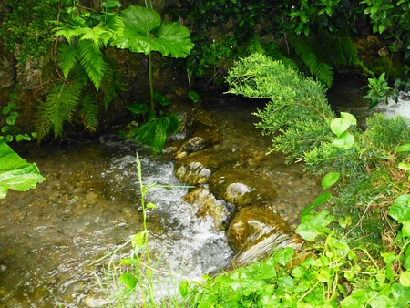 flowing river: small waterfall in flowing river
