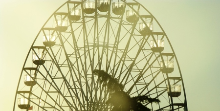 Silhouette of a ferris wheel at sunset Stock Photo