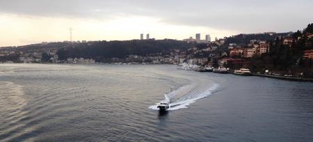 waterside: istanbul bosphorus strait with waterside residences and speedboat