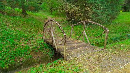 Wooden bridge over small river. Ataturk Arboretum, Istanbul, Turkey - October 25, 2015.