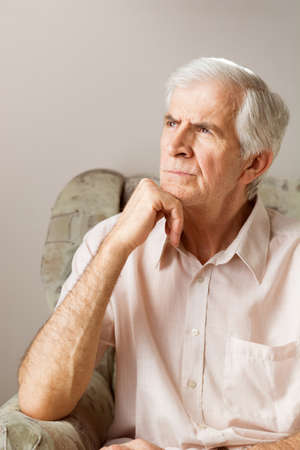 Mature man thinking and looking away Stock Photo