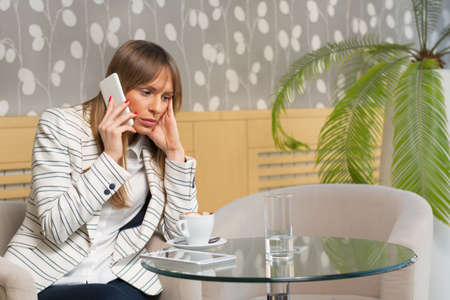 Shot of a young businesswoman looking dismayed after receiving bad news on the phone