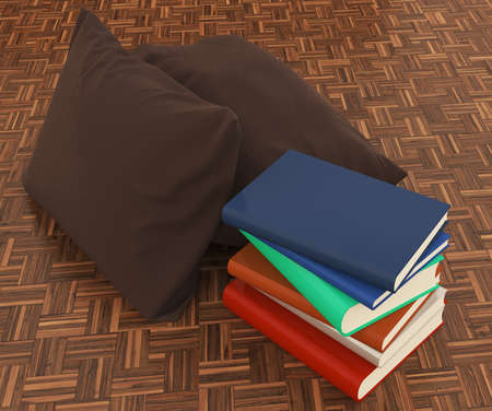 Pillow and books on wood floor  photo