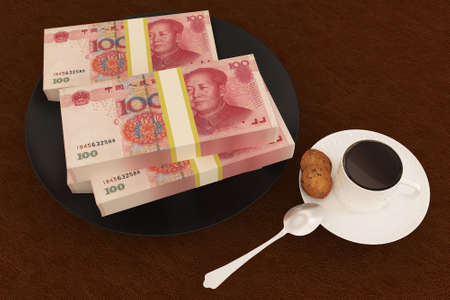 Money yuan on dish and coffee photo
