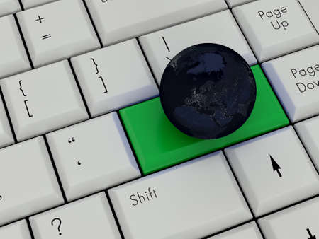 Laptop Keyboard With Earth On Enter Key photo