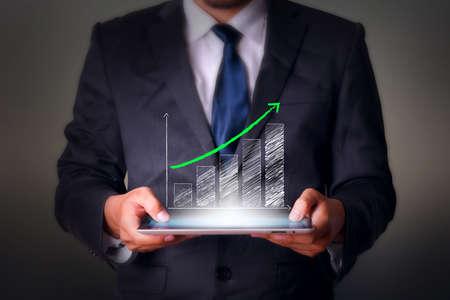 タブレット コンピューター ビジネス技術成功グラフ 写真素材