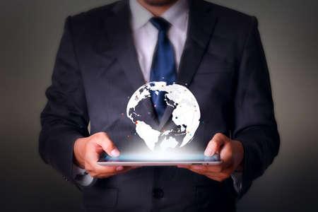 タブレット コンピューター ビジネス技術と世界地図 写真素材