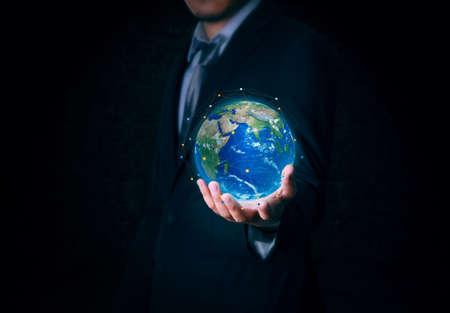 World map on hand businessman Stock Photo