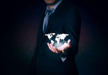 background information: World map on hand businessman Stock Photo