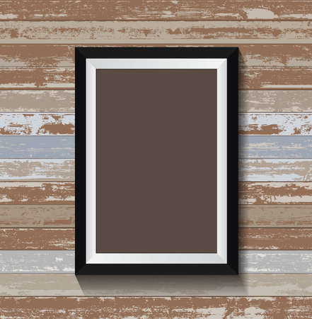 Blank empty frame or poster on old wood texture