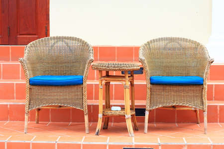 Two wicker chairs photo