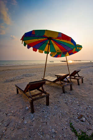 evening light on the beach clear sky with color umbrella photo