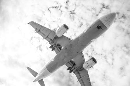 Plane is taking off  black and white