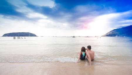 Young happy couple on the beach Фото со стока