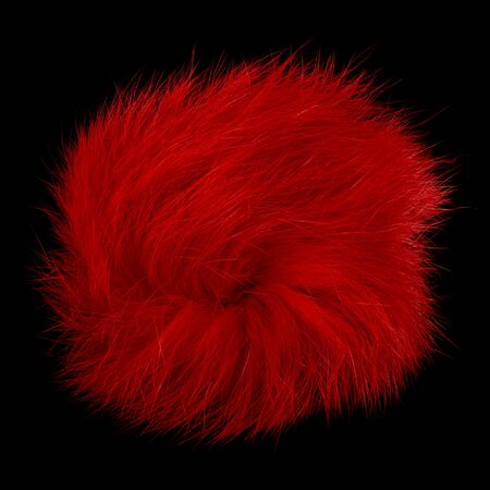 Closeup of red rabbit fur pompom isolated on black background