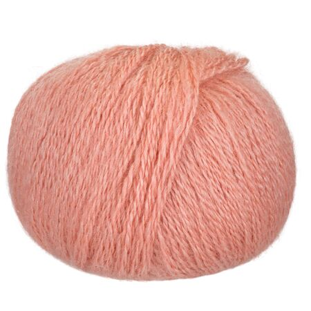 A closeup of peach mohair and silky yarn. Isolation on a white background. Space for text. Reklamní fotografie