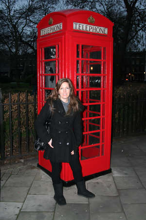 sidewalk talk: Beautiful Woman at a London Telephone Booth Stock Photo
