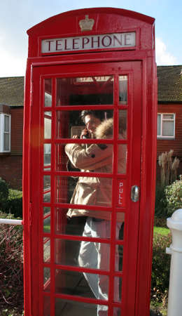 Man in London Telephone Booth Stock Photo - 20718830